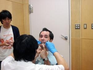 Dr. Atsuo Suemitsu attaches the sensors with tape, super glue, and determination.